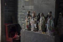 Los chinos apoyan estados religiosos del callejón en Shenzhen China Fotos de archivo