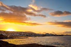 Los Christianos coastline. Rocky coastline in Los Cristianos resort on the sunrise on Tenerife island in Spain Royalty Free Stock Images
