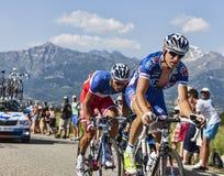 Los ciclistas Alexandre Geniez y Arthur Vichot Imágenes de archivo libres de regalías