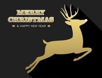 Los ciervos del oro del Año Nuevo de la Feliz Navidad siluetean la tarjeta Fotografía de archivo libre de regalías