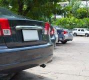 Los coches modernos son el jardín del estacionamiento Imagen de archivo libre de regalías