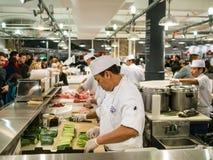Los cocineros en Chelsea Market Imagen de archivo