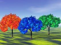 Los colores básicos representados por los árboles Imágenes de archivo libres de regalías