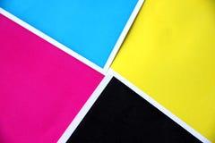 Los colores cubren espolones en cuadrados. Imagen de archivo