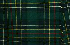 Los colores de la falda escocesa de la tela escocesa de tartán significan orígenes de la familia del clan Foto de archivo libre de regalías