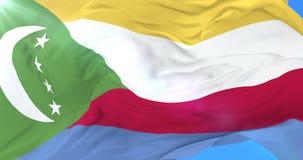 Los Comoro señalan agitar por medio de una bandera en el viento con el cielo azul, lazo