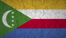 Los Comoro señalan por medio de una bandera con el efecto del papel arrugado y del grunge stock de ilustración