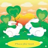 Los conejos aman la tarjeta del vector de los corazones con el lugar para el texto Fotos de archivo