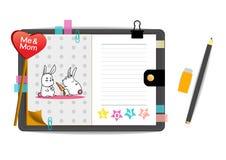 Los conejos yo y de la mamá con amor pican el cuaderno Imagen de archivo