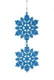 Los copos de nieve azules de la decoración de la ejecución de la Navidad Fotos de archivo
