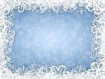 Los copos de nieve enmarcan en fondo escarchado Foto de archivo libre de regalías