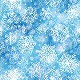 Los copos de nieve modelan en fondo azul ilustración del vector