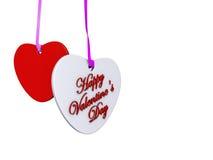 Los corazones colgantes de la tarjeta del día de San Valentín Fotografía de archivo