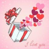 Los corazones de la tarjeta del día de San Valentín vuelan el rectángulo de regalo Imagenes de archivo