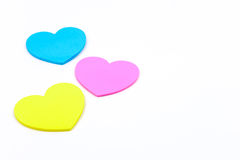 Los corazones de papel formaron azul del color y amarillo rosados Foto de archivo libre de regalías
