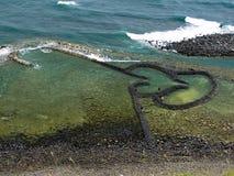 Los corazones gemelos empiedran el vertedero de marea Foto de archivo libre de regalías
