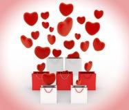 Los corazones que caen en el regalo empaquetan Fotos de archivo libres de regalías