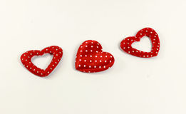Los corazones rojos en el fondo blanco Fotografía de archivo