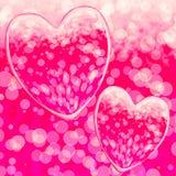 Los corazones rosados diseñan en un Bokeh Fotografía de archivo