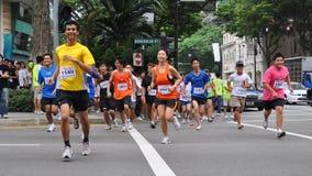¡Los corredores en ahora crean la acción! (PUEDA) ejecutado Foto de archivo libre de regalías