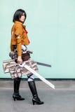 los cosplayers se visten como los caracteres de la historieta y del juego Fotos de archivo