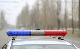 Los costes del coche policía en el camino Fotografía de archivo