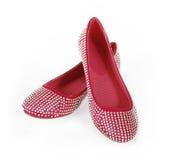 Los cristales encrusted los zapatos planos rojos fotos de archivo