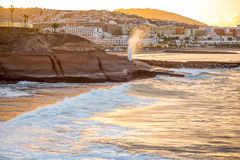 Los Cristianos beach with geyser. Splashing water on the sunrise on Tenerife island in Spain Stock Photography