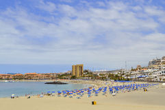 Los Cristianos beach. Tenerife, Canary Islands, Spain, Europe - June 13, 2016: Tourists on the beach enjoying the sun Royalty Free Stock Photography