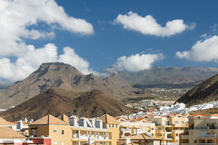 Los Cristianos And Mountains, Tenerife, Spain. Los Cristianos in front of the Roque del Conde in Tenerife, Spain Stock Images