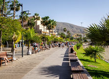 Los Cristianos promenade. Tenerife, Spain-December 22, 2014: People walking along the Los Cristianos promenade.  Los Cristianos is one of the most popular and Stock Image