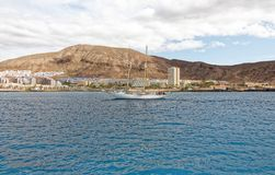 View from sea of Los Cristianos bay, Tenerife, Spain. Los Cristianos is a town on the southwest coast of Tenerife, the largest of Spain's Canary Islands. A Stock Image