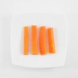 Los cuatro palillos de zanahoria anaranjados frescos imágenes de archivo libres de regalías