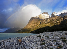 Los Cuernos, Lake Pehoe and rainbow. Torres del Paine National Park in Chile royalty free stock photo