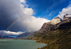 Los Cuernos, Lake Pehoe and rainbow. Torres del Paine National Park, Chile royalty free stock image