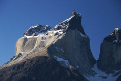 Los Cuernos summit. Sun-lit granite cliff in Torres del Paine national park Stock Images