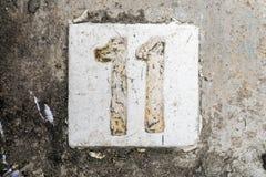 Los dígitos con hormigón en la acera 11 Fotografía de archivo