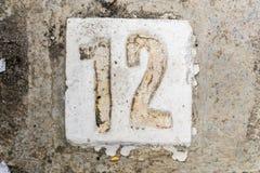 Los dígitos con hormigón en la acera 12 Fotografía de archivo