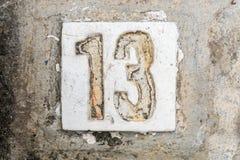 Los dígitos con hormigón en la acera 13 Imágenes de archivo libres de regalías