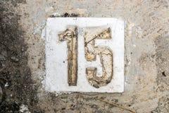 Los dígitos con hormigón en la acera 15 Foto de archivo libre de regalías