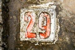 Los dígitos con hormigón en la acera 29 Imagen de archivo