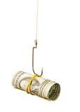 Los dólares son el cebo en un gancho de leva fotografía de archivo