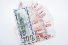 Los d?lares y las rublos Concepto del asunto foto de archivo