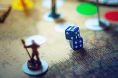 Los dados están en los juegos de mesa de la fantasía del fondo Foto de archivo libre de regalías