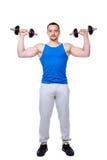 Los deportes sirven hacer ejercicios con pesas de gimnasia Imagen de archivo