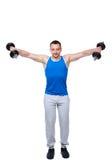 Los deportes sirven hacer ejercicios con pesas de gimnasia Fotos de archivo