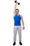 Los deportes sirven hacer ejercicios con pesas de gimnasia Imágenes de archivo libres de regalías