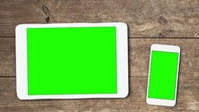 Los dispositivos móviles con greenscreen almacen de metraje de vídeo