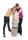 Los dos estudiantes jovenes aislados en un blanco Foto de archivo libre de regalías