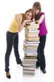 Los dos estudiantes jovenes aislados en un blanco Fotografía de archivo libre de regalías